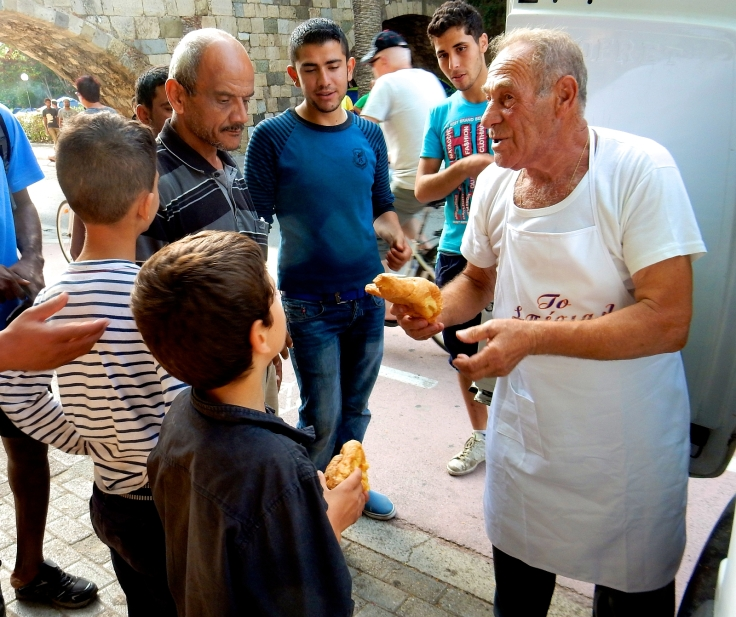 Greece-Headline-News-Dionysis-Arvanitakis-Feeds-Thousand-Refugees-With-Breads