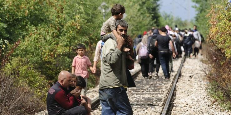 Migrants walk towards Gevgelija, Macedonia after crossing Greece's border into Macedonia